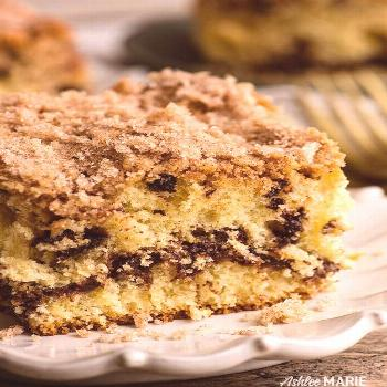 this chocolate chip coffee cake is made with sour cream to keep it moist, has a sweet cinnamon ribb